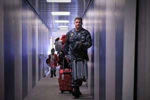 Flickr_-_Official_U.S._Navy_Imagery_-_Sailor_carries_bags_for_U.S._military_family_members_arriving_in_Florida_after_evacuating_Japan.