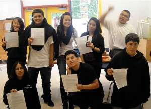 Youth-proudly-raise-their-scholarship-letters-to-City-College-of-San-Francisco