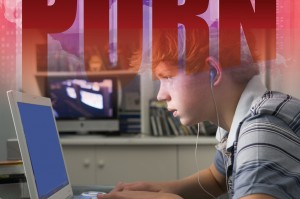 Image of youth looking at laptop computer