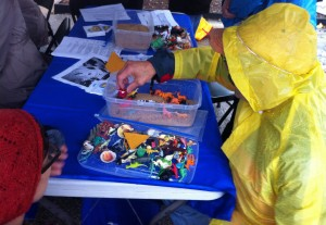 A person creates a scene in a sand tray in the UMSL counseling tent in October. Photo courtesy of Brian Hutchinson.