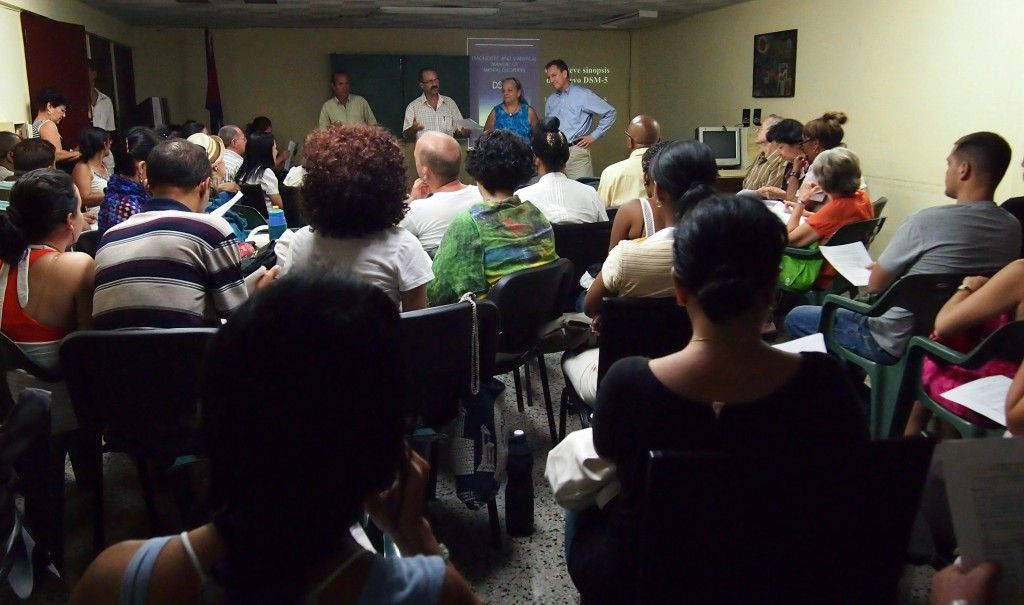 Moody (top right) participates in a presentation on the DSM-5 to faculty and students in the School of Psychology at the University of Havana in May 2013.
