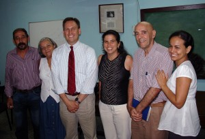 Moody (third from left), with faculty from the University of Havana School of Psychology:  M.Sc. Reynaldo Rojas, the vice-dean of foreign relations and research; Professor Marta Martínez, an industrial organizational psychologist (who often serves as a translator for Moody); Dean M.Sc. Karelin López Sanchez, Dr. Eduardo Cairo, professor of neuropsychology and clinical psychology; M.Sc. Greter Saura, a vice-dean of distance education and professor of developmental psychology.