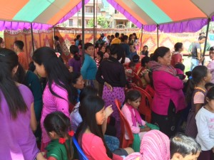 ENG families huddle in a tent to wait out an aftershock.