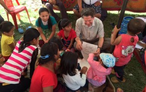 Jeffrey Kottler, top center, plays a game to soothe and distract children in the Empower Nepali Girls program.