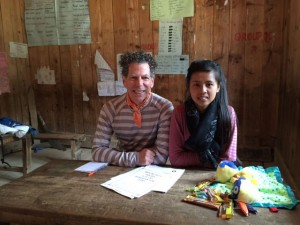 "Kottler and an ENG translator wait for their next patient in the ""counseling corner"" of a makeshift ENG medical center setup in a school."