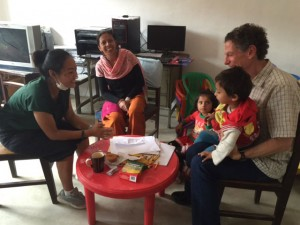 Kottler and one of his students (far left) in the middle of a counseling session with a Nepali family.