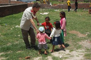 Jeffrey Kottler plays with some Nepali youngsters near an Empower Nepali Girls medical tent.
