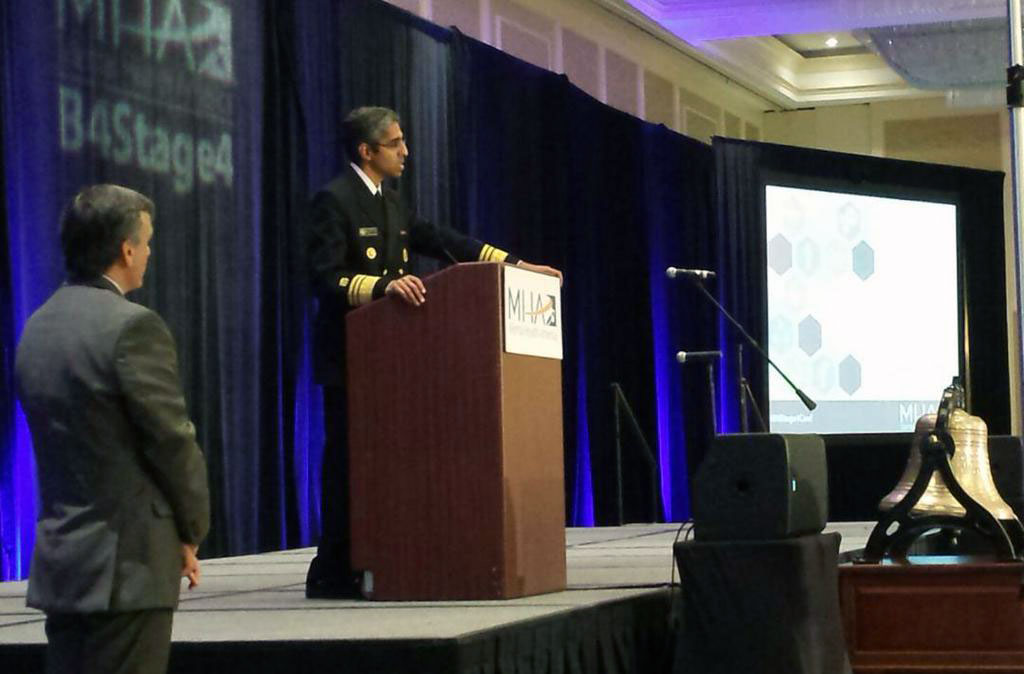 Mental Health America President and CEO Paul Gionfriddo (far left) looks on as U.S. Surgeon General Vivek Murthy takes questions from the audience at the opening session of MHA's annual conference last week.