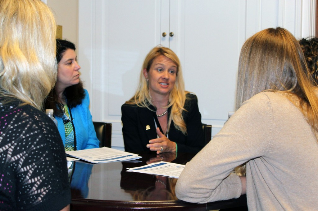 Stephanie Dailey, president of the Maryland branch of the American Counseling Association and senior co-chair of ACA's Ethics Committee, talks with an aide in the office of Rep. Robert Wittman (R-Va.).