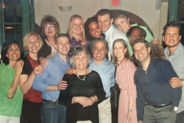 "Catherine Roland, surrounded by students from the first counselor Ph.D. cohort at Montclair State University, at a farewell dinner held for her as she was leaving the university in 2013. Roland was instrumental in creating the university's counselor Ph.D. program. The students gave her  this photo in a frame inscribed with the words ""Thank you for believing in us!"""