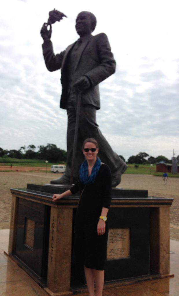 The author in front of a statue of Hastings Kamuzu Banda, the first president of Malawi.