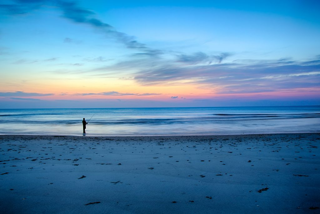Surf fishing before sunrise in the Outer Banks, North Carolina