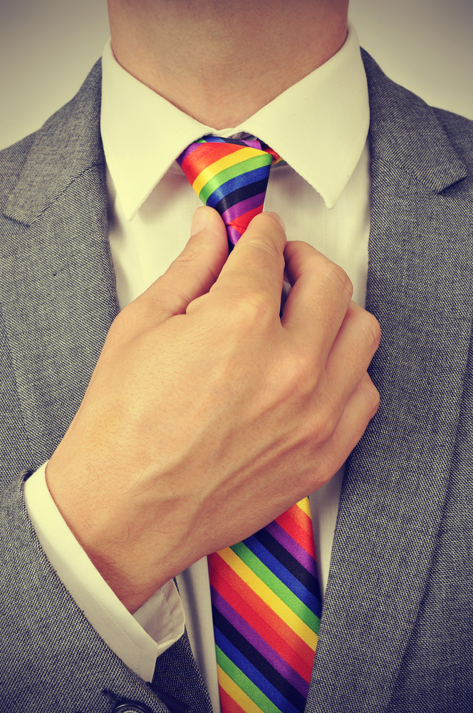 businessman with a rainbow necktie, with a slight vignette added
